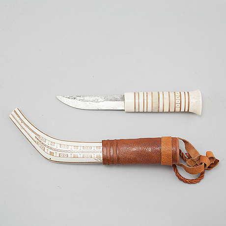 A knife by svante larsson, signed.