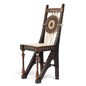CARLO BUGATTI, an ebonized wood and walnut chair, Turin, Italy ca 1900.