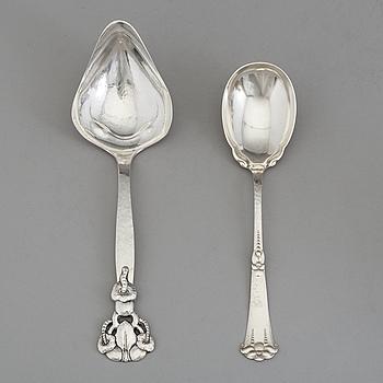 Two Art Nouveau silver serving spoons maker's marks Carl V Larsen, Copenhagen 1912 and Jonas Leo Nordin, Sollefteå 1924.