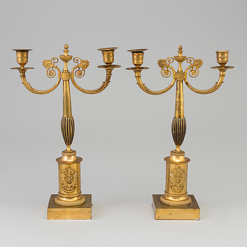 EMPIRE, A pair of early 19th century ormolu candlestick.