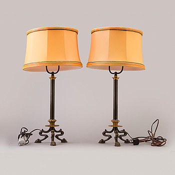 A pair of first half of the 20th century bronze table lamps.