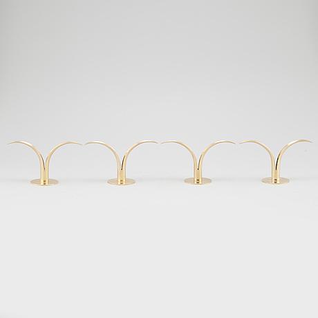 "Four brass candle sticks ""liljan"" by ivar Ålenius björk for ystad metall, second half of the 20th century"