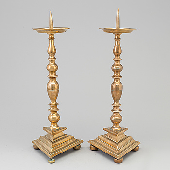 A 17th century bronze candlesticks.