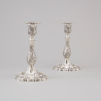 A Swedish 20th century pair of rococo-style silver candlesticks mark of A Hamnstedt Stockholm 1950.