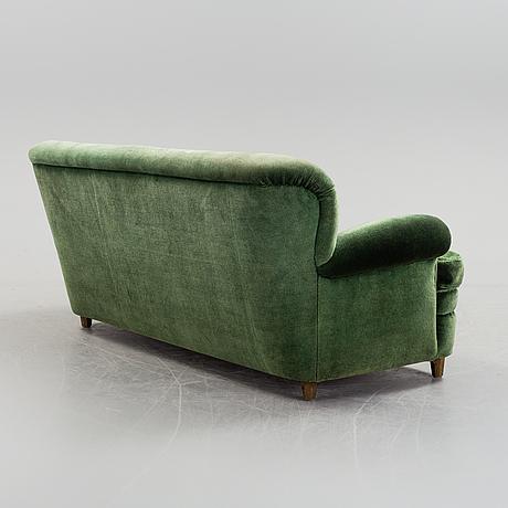 A sofa designed by josef frank, firma svenskt tenn. model 678
