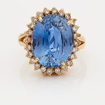 903. A RING set with a faceted sapphire.