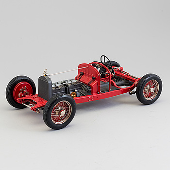 A plastic and metal model of an 1931 Alfa Romeo 8 C by Pocher.