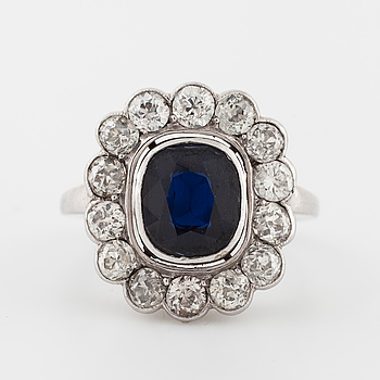 An oval faceted sapphire and old cut diamond ring with Swedish import mark.