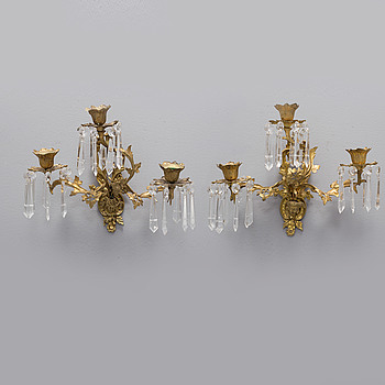 A pair of second half of the 20th century rococo style wall sconces.
