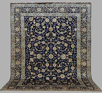 A CARPET, Kashan , signed, around 415 x 315 cm.