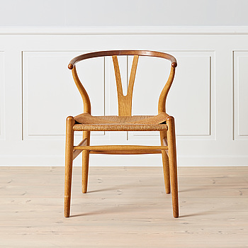 HANS J WEGNER, An early oak and teak 'Wishbone chair' by Carl Hansen & Son, Denmark, 1950's.