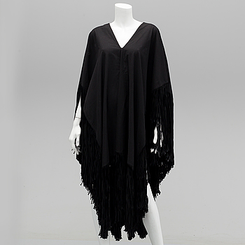 PONCHO, Yves Saint Laurent.