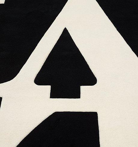 "Robert indiana, a carpet, ""white on black"", chosen love, hand tufted in 1995, ca 243,5 x 244,5 cm, robert indiana."