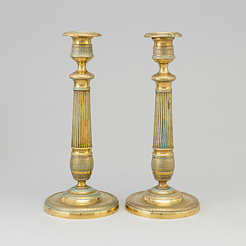 EMPIRE, A pair of brass candlesticks, France, second quarter of the 19th century.