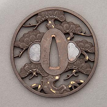 A 19th Century Japanese signed bronze Tsuba.