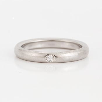 RING, Tiffany wedding band in platinum with one diamond 0.02 cts.
