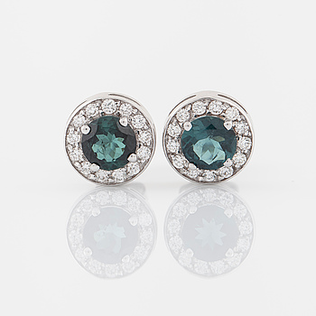 A pair of bluish green tourmalines and brilliant cut diamond earrings.