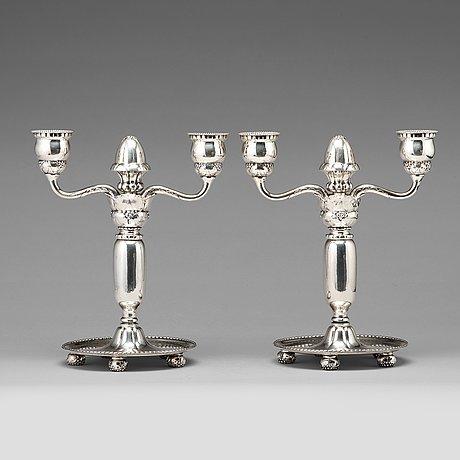 Georg jensen, a pair of 830/1000 silver two light candelabra, copenhagen 1918, model nr 93.