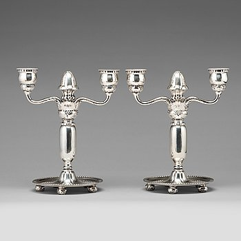 122. Georg Jensen, a pair of 830/1000 silver two light candelabra, Copenhagen 1918, model nr 93.