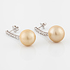 Earrings, with culture pearl and brillinat cut diamond.