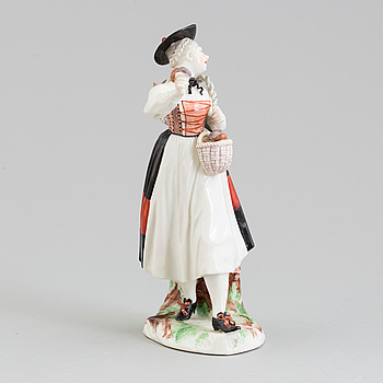 A Nymphenburg porcelain figure of a mushroom sales woman, Germany, 20th Century.