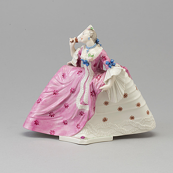 A Nymphenburg porcelain figure of a lady, Germany, 20th Century.