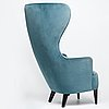 """Tom dixon, a tom dixon """"wingback chair"""" produced in great britain before 2015"""