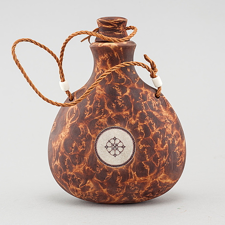 A flask by roger saitton, signed rs and dated 2008