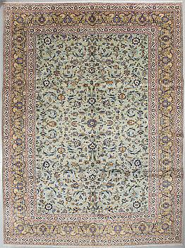 A Keshan rug, 412 x 305 cm.