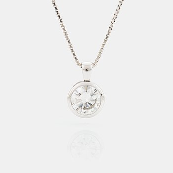 A PENDANT set with a round brilliant-cut diamond.