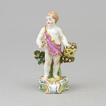 A Samson porcelain figure of a boy with flowers, Paris, France circa 1900.
