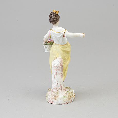 A samson figure of a woman with a flower basket, paris, france 20th century.