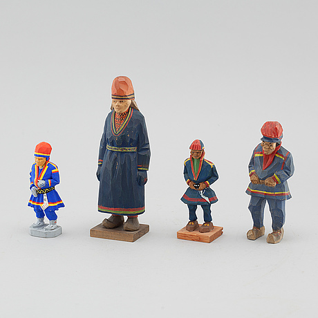 Four wooden figures, one by lorens larsson, partly signed