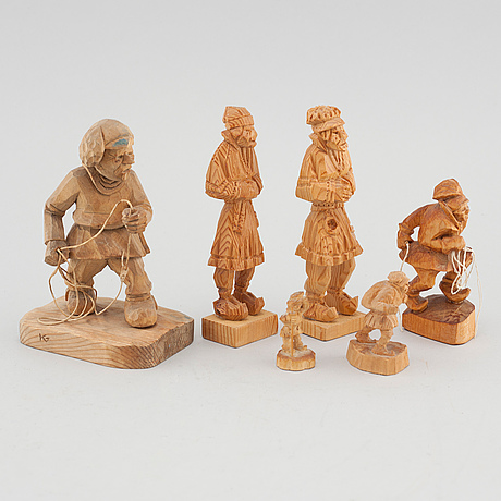 Six wooden figures, signed.