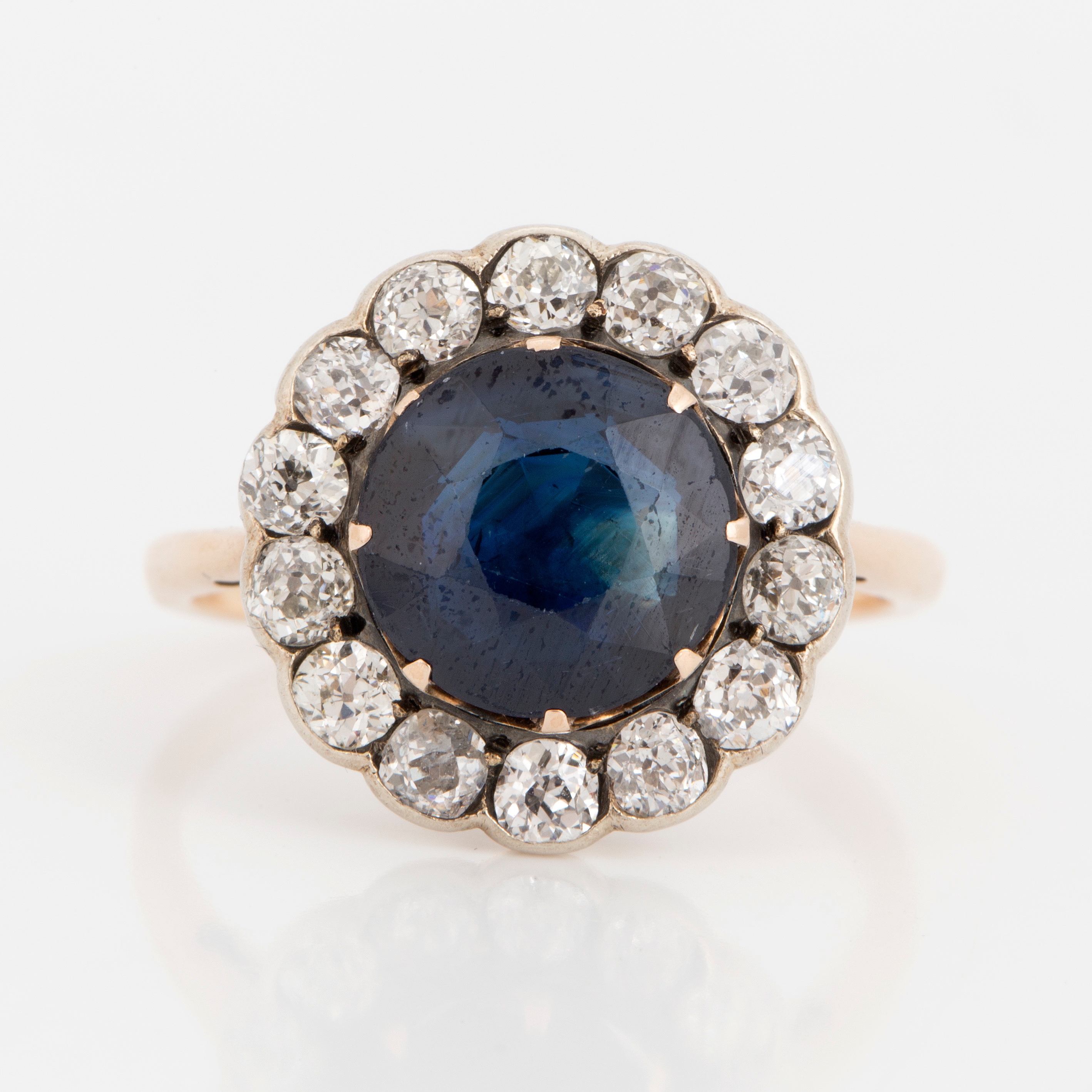 jewellery showing dress with single dark oval the stone gold through x sapphire ring owned window claw blue set white two light a by cut pre flanked