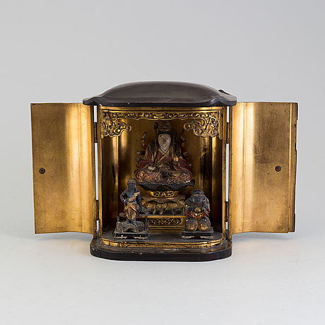 A japanese wooden lacquered altar piece, with buddha and two deites, early 20th century.