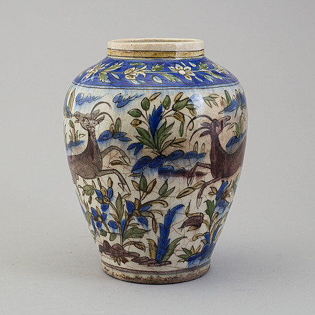 A pottery urn, probably late qajar dynasty, persia/iran, height ca 27,5 cm.