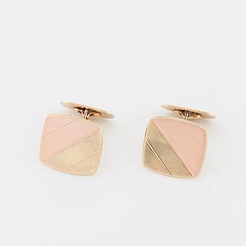 A pair of cufflinks.
