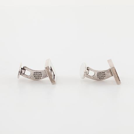 Niels erik from, nakskov, denmark, a pair of cufflinks.