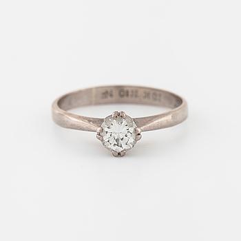 RING, med briljantslipad diamant ca 0.46 ct, importstämplad 1987.