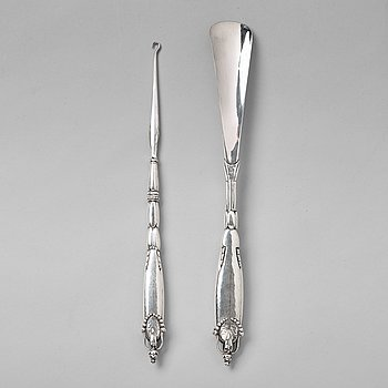124. Georg Jensen, a shoehorn and a tool for tying shoe laces, Copenhagen ca 1918-20, 830/ 1000 silver.