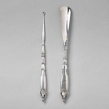 124. GEORG JENSEN, skohorn och kängknäppare, Köpenhamn ca 1918-20, 830/1000 silver.