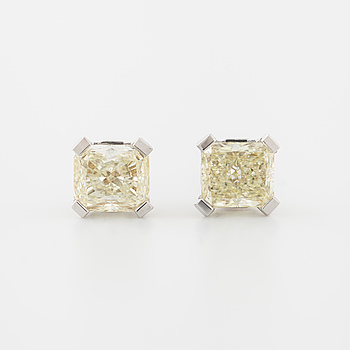 A pair of radiant cut diamond earrings.