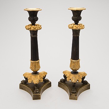 Pair of late empire bronze candlesticks, mid 19th Century.