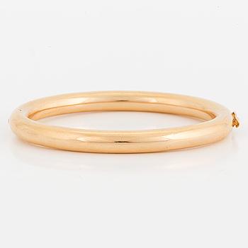 ARMRING, 18K guld, oval och ihålig.