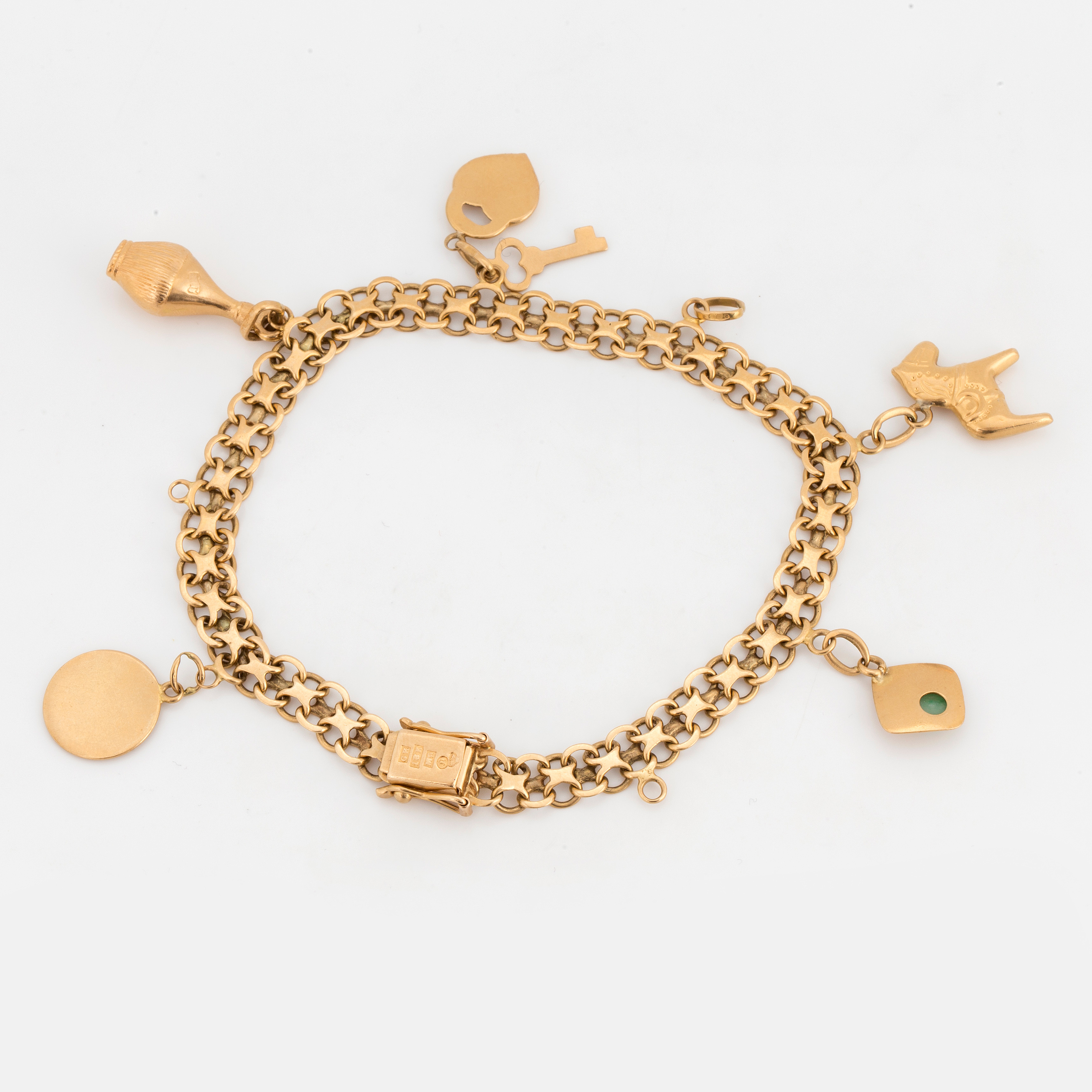 CHARM BRACELET, 18K gold with 5 charms and 3 free loops  - Bukowskis