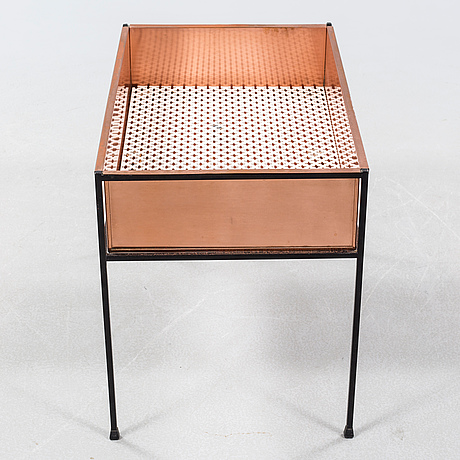 A copper flower stand
