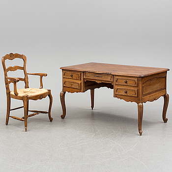 A first half of the 20th century writing desk and chair.