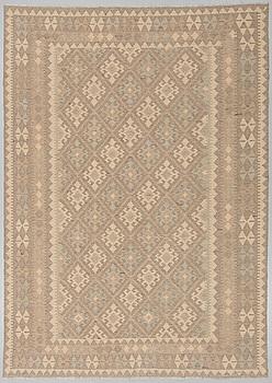 An oriental kilim, around 296 x 212 cm.