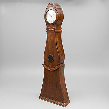 A long-case clock, marked 'Mora', dated 1772.